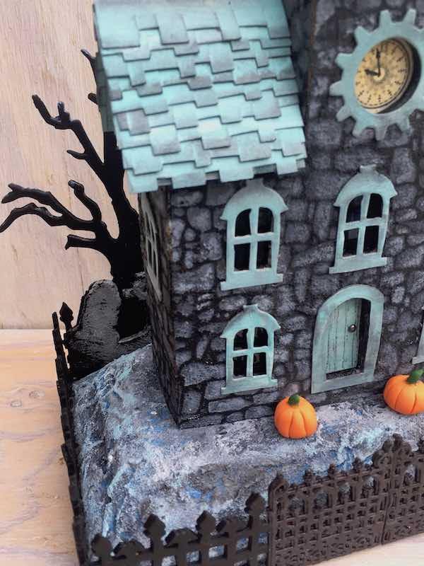 Clock House with stenciled stone texture and spooky bat wing fence creepy tree