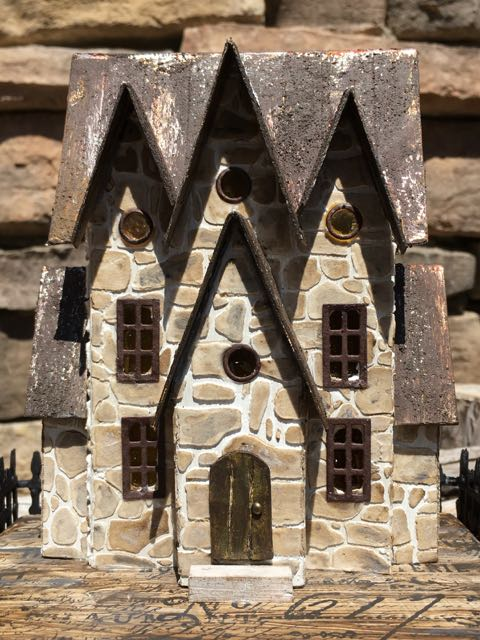 Stone House with 3 gables is a paper-based house stenciled and painted to look like stone to be decorated as a Halloween house #halloweenhouse #putzhouse #halloween #papercraft