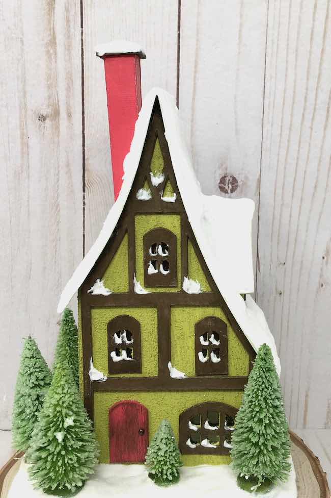 Storybook Holiday cottage with trees and glittered snow