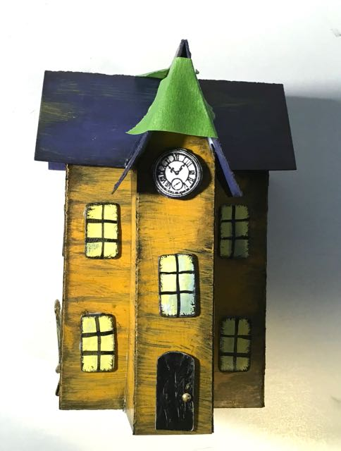 Tape around the gable of the clock tower halloween paper house