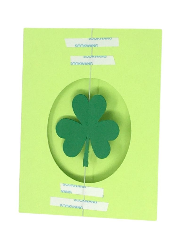 Tape down elastic thread so shamrock can spin