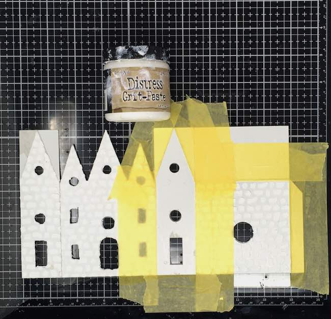 Tape stencil to cardboard