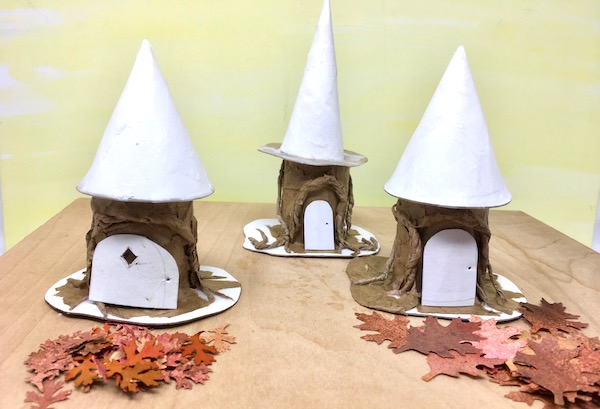 Test fitting cones and doors on the little tree stump paper houses