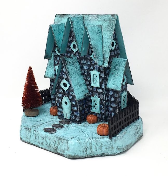Miniature Halloween house called the Stone House with 3 gables