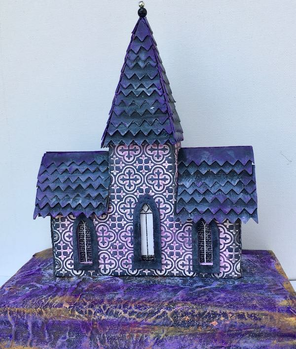 The Tower House very purple embossed Halloween house