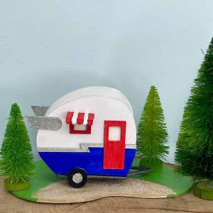 Tiny Paper Camper painted in red white and blue colors. Also has Shasta wings
