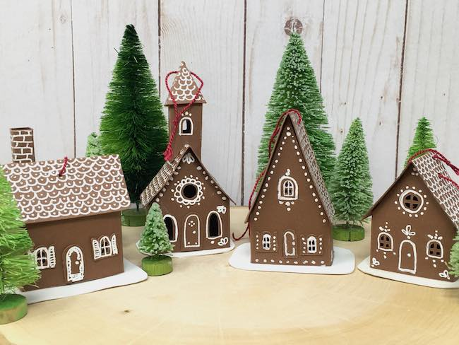 Tiny houses decorated with white gel pen
