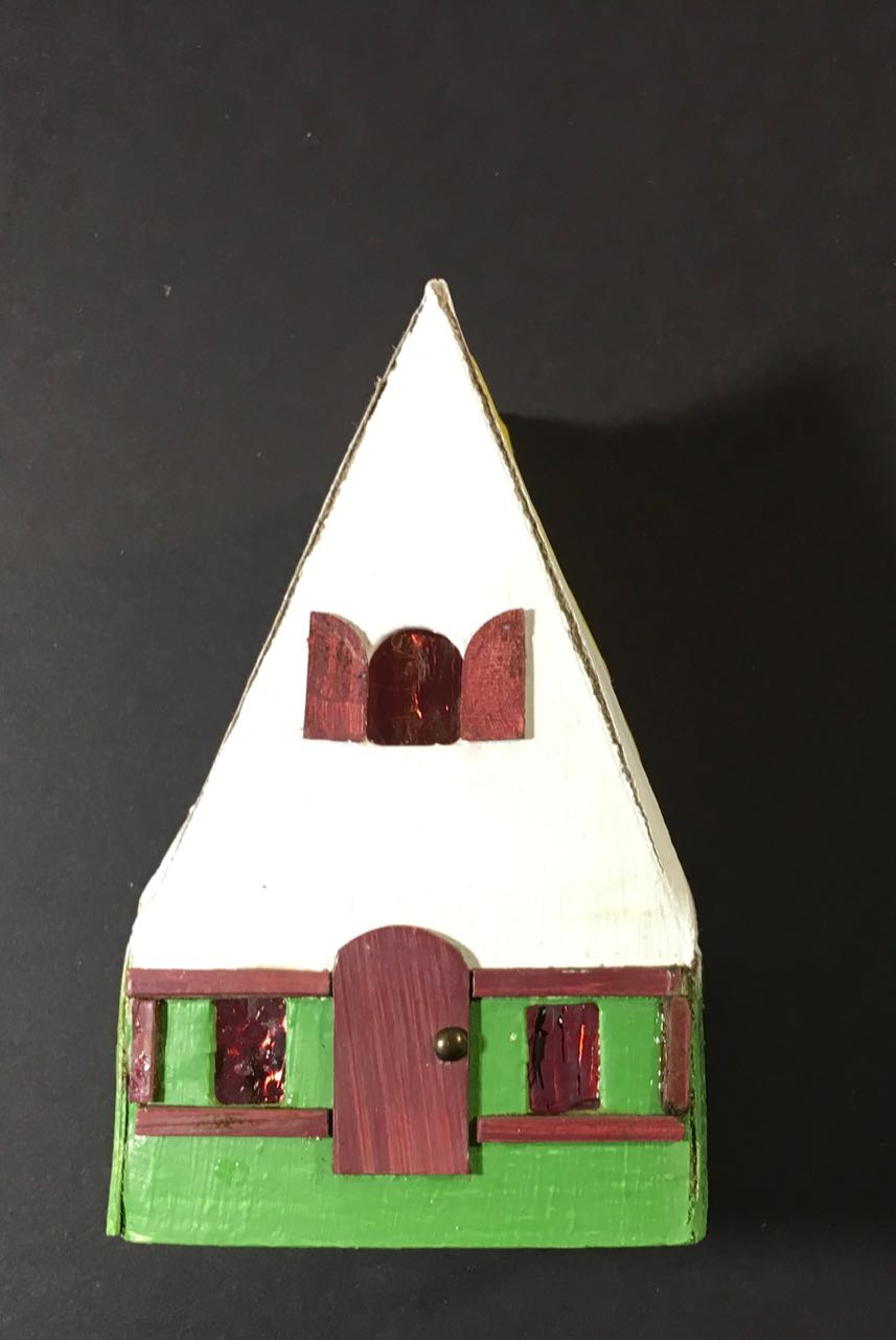 Add the trim on your Swiss Chalet Christmas paper house