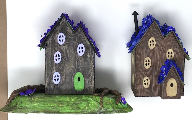 Two paper fairy houses one with cardboard base one without