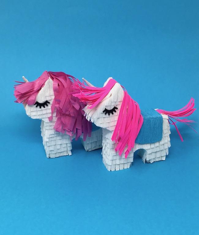 Two mini pinatas as unicorns - copy paper tissue paper