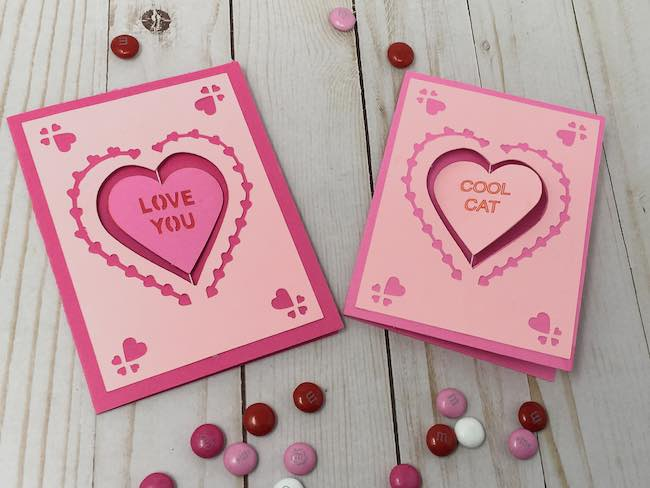 Two spinning heart cards