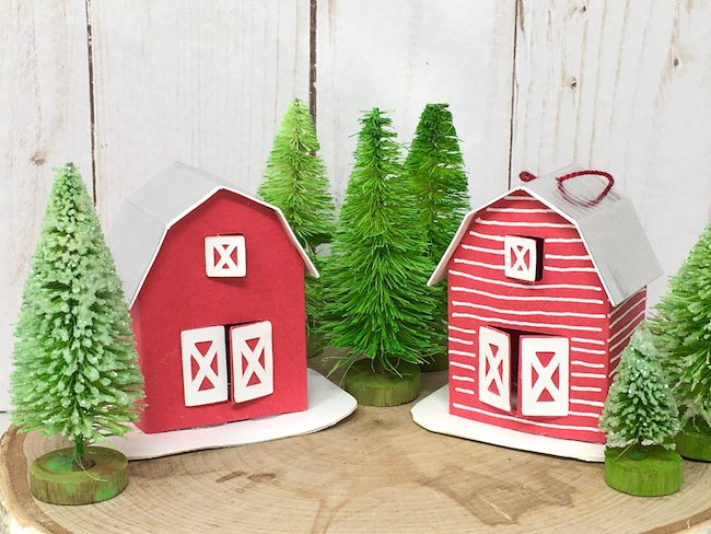 Two tiny barn paper ornaments