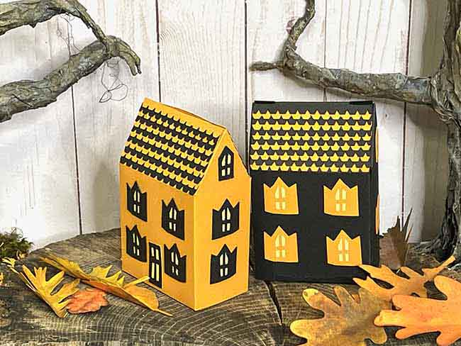 Two versions of the Haunted Cottage treat boxes black and orange