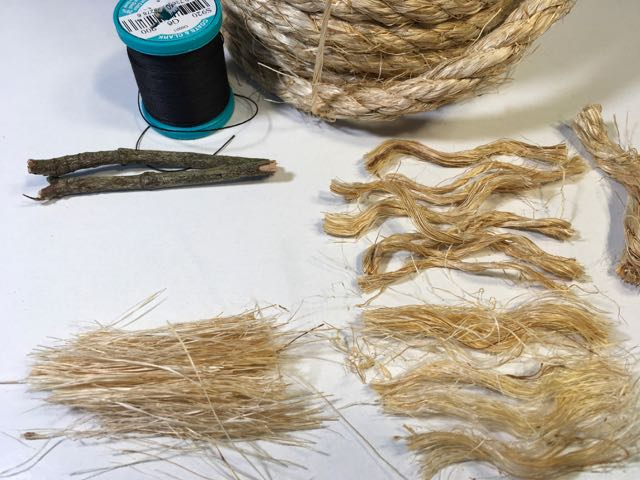 Sections of sisal rope cut to form straw for your DIY miniature broom
