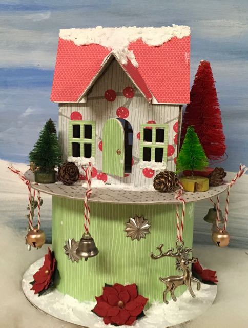 Village dwelling Putz house on a ribbon rolls with dangling charms