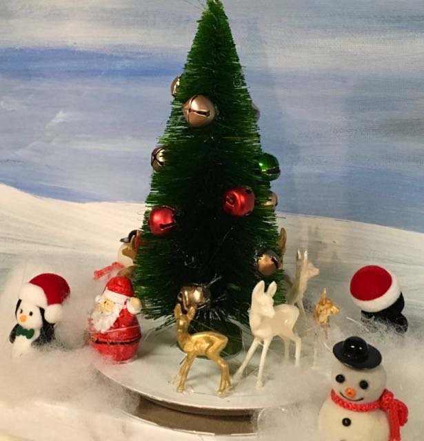 Whimsical diorama of tree and santa and deer