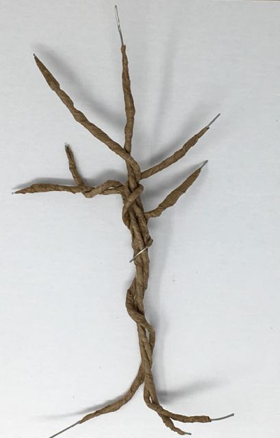 2-3 strings of paper-covered wire twisted together forming the twisted tree