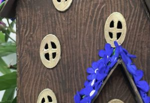 Debossed wood grain on blue violet fairy house