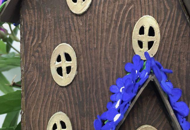 Debossed wood grain on blue violet fairy house