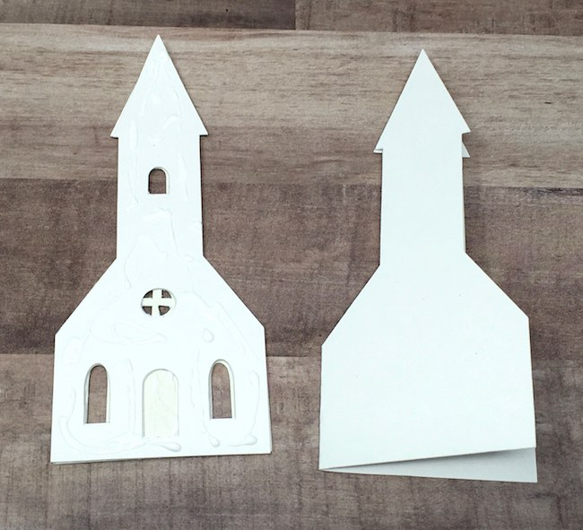 apply glue to backing piece of church