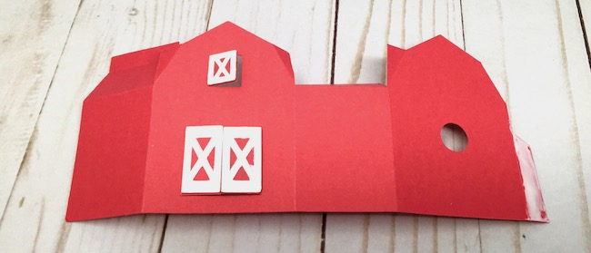 apply glue to glue tab to assemble the paper barn