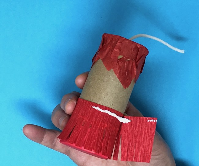 apply glue to hold crepe paper fringe in place
