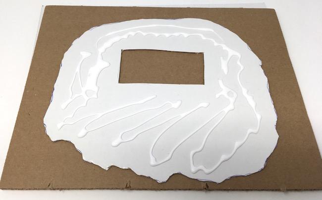 apply glue to reinforcement cardboard sandy beach base