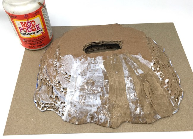 apply mod podge to adhere recycled paper strips