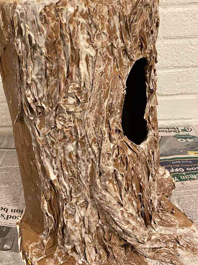 apply wrinkled twisted paper to mimic bark paper mache tree stump