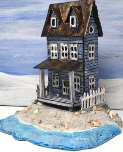 Sea Worn beach Putz house with blue sky background
