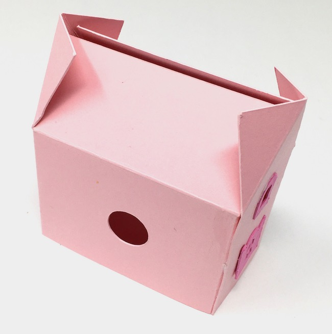 body of miniature paper cottage glued together