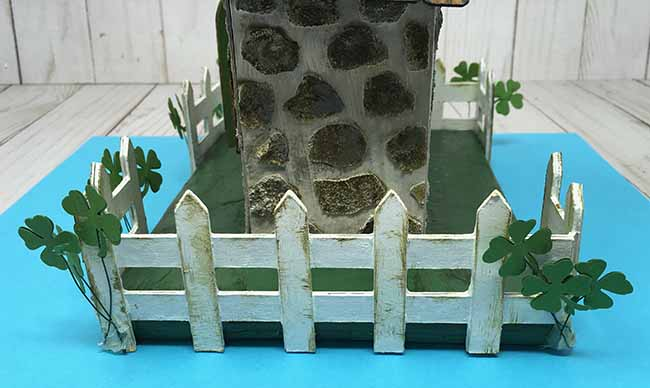 cardboard fence dimension with paper shamrocks