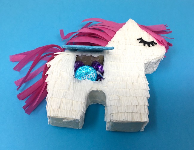 fill mini unicorn pinata with treats or candy