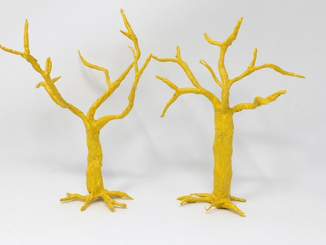 yellow paint layer on twisted tree for easy diy spring blossom tree