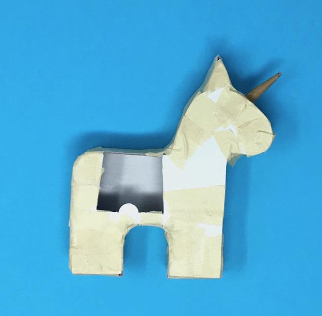 front piece taped on unicorn pinata