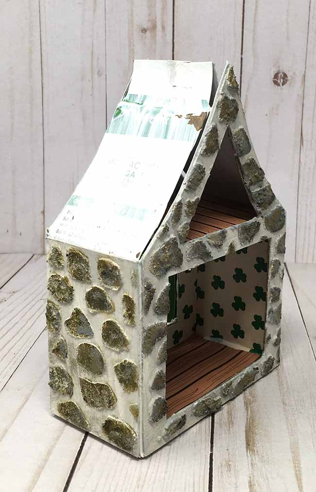 glue roof flaps together to support the cardboard leprechaun house