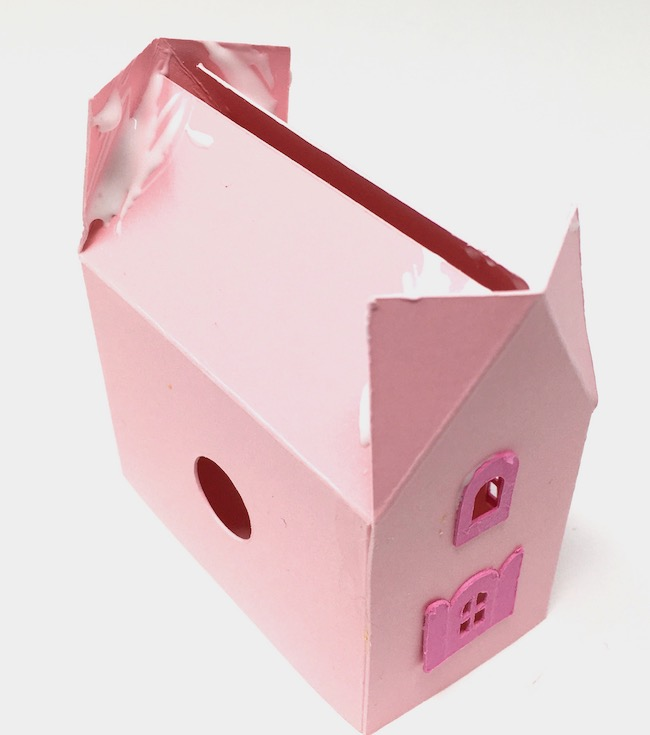 glue roof tabs to roof flaps on mini paper house