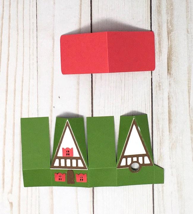 glue windows, door and trim to miniature swiss chalet house
