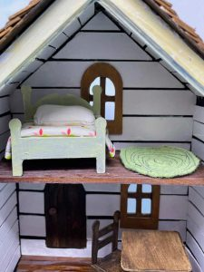 inside of miniature fixer upper house with shiplap