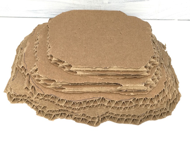 layers of cardboard for sandy beach cardboard base