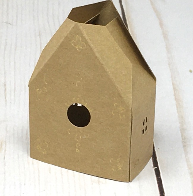 miniature house assembled with side tab glued to house