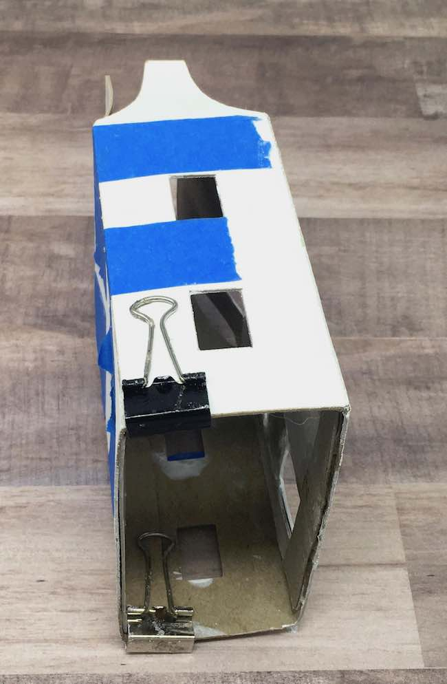 painters tape helps hold cardboard pieces together