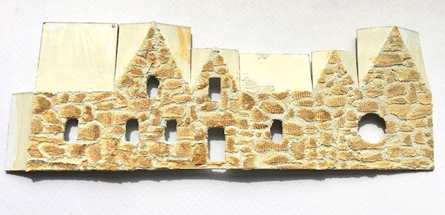 painting layers of color on stones miniature Irish Stone Cottage