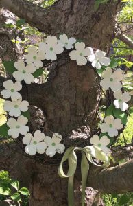 easy paper dogwood flowers on grapevine wreath on a real dogwood branch