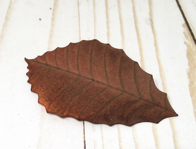 paper leaf stained with fall distress stain color
