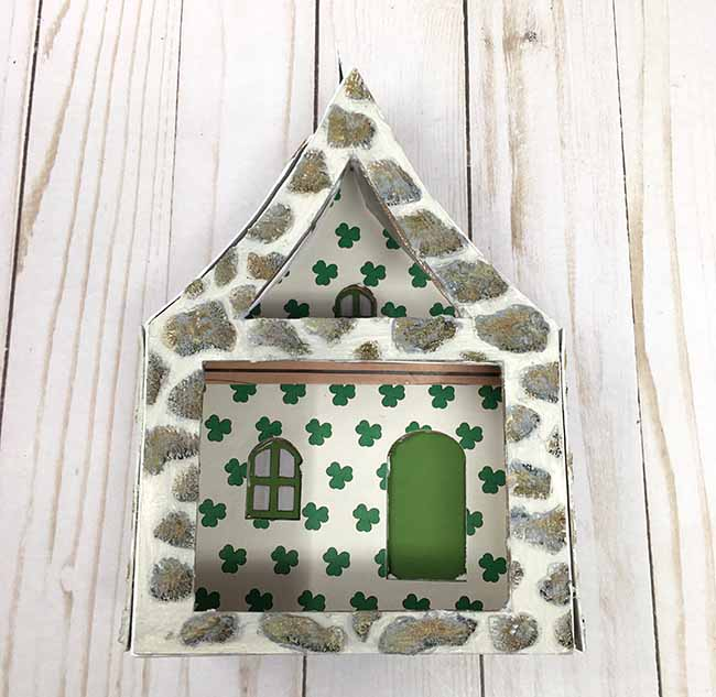 shamrock wallpaper glued inside of leprechaun house