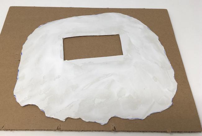 smear glue for bottom layer of cardboard base for miniature beach house