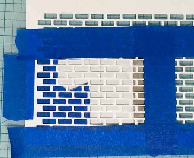 tape-down-the-stencil-for-chimney