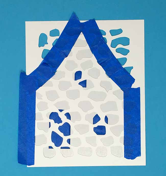 tape stencil firmly to cardboard and stencil to simulate stone surface
