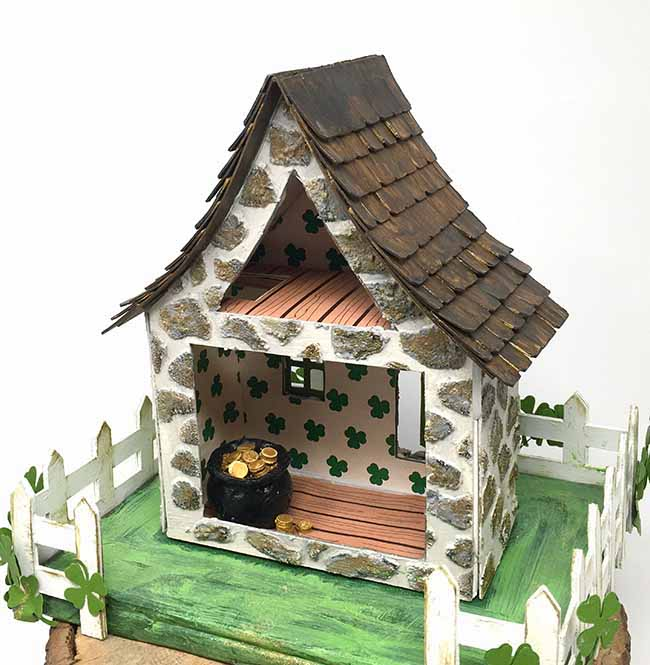 tiny pot of gold inside miniature irish cottage